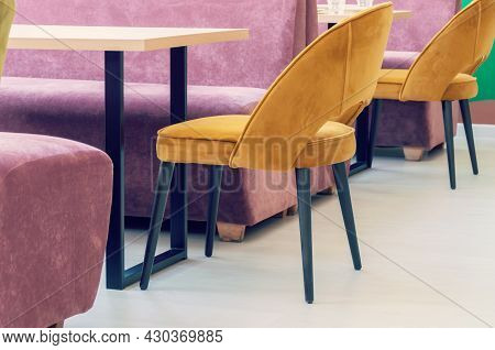A Row Of Tables With Soft Comfortable Violet Chairs For Visitors To The Food Court Of A Modern Shopp