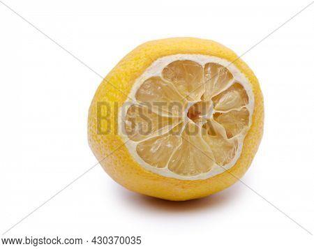 Slice of bad dry lemon isolated over white background