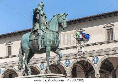 Statue of Ferdinando I de Medici Grand Duke of Tuscany located in the Piazza della Santissima Annunziata in Florence Italy poster