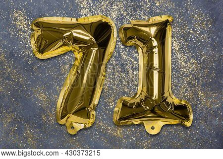 The Number Of The Balloon Made Of Golden Foil, The Number Seventy-one On A Gray Background With Sequ