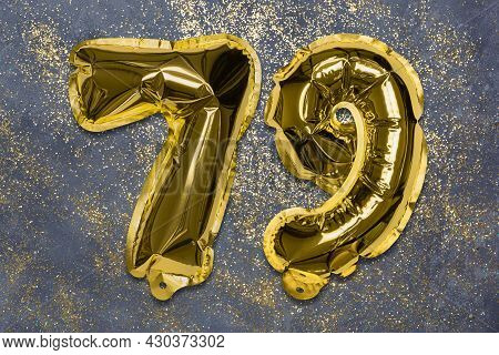 The Number Of The Balloon Made Of Golden Foil, The Number Seventy-nine On A Gray Background With Seq