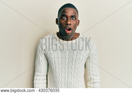 Young african american man wearing casual clothes afraid and shocked with surprise and amazed expression, fear and excited face.