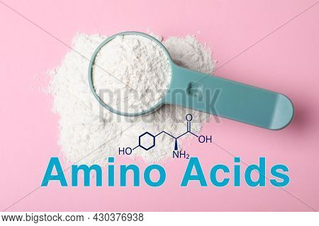 Measuring Scoop Of Amino Acids Powder On Pink Background, Top View