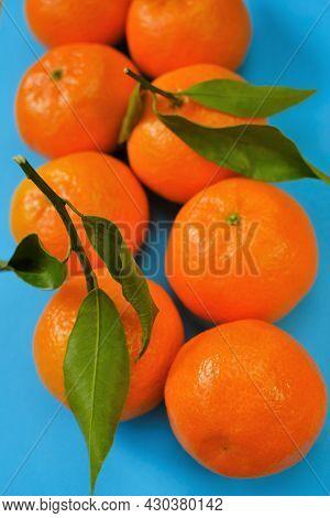 Tangerines Fruits. Fresh Citrus Fruits On A Blue Background.organic Farm Tangerines.