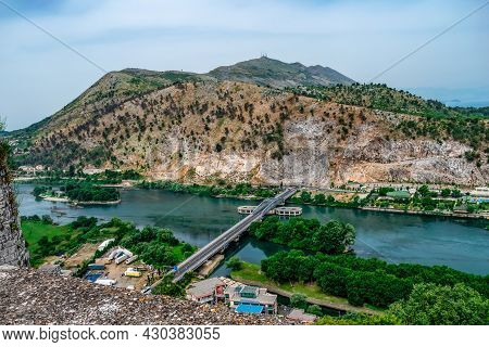 Amazing Landscape Of The Buna River With The Ura Bunes Shkoder Bridge - View From Rozafa Castle. Bei