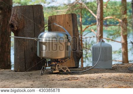 Traveler Foods For Outdoor Activities. Food In Pot In The Green Forest. Camping Food Making.