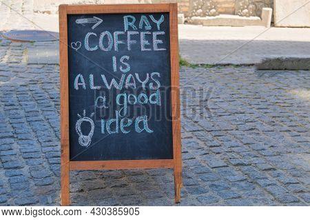 Black Board Menu Black Color, Message Or Advertising. Chalkboard Is Standing Near The Restaurant. Su