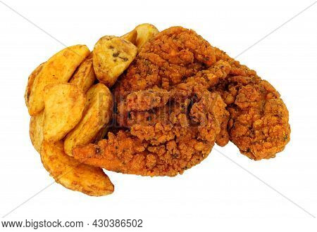 Fried Spicy Breadcrumb Covered Chicken Fillets And Potato Wedges Meal Isolated On A White Background