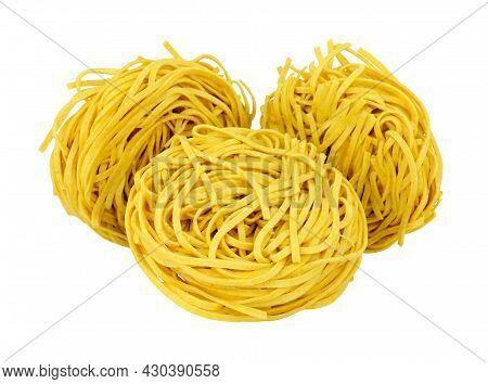 Chinese Dried Medium Egg Noodle Nests Isolated On A White Background