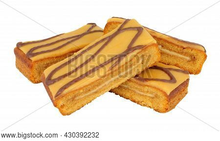 Caramel Flavour Sponge Cake Slices Topped With Salted Caramel Icing Isolated On A White Background