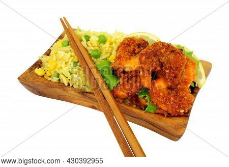 Spicy Breadcrumb Coated King Prawns And Egg Fried Rice In An Olive Wood Serving Dish Isolated On A W