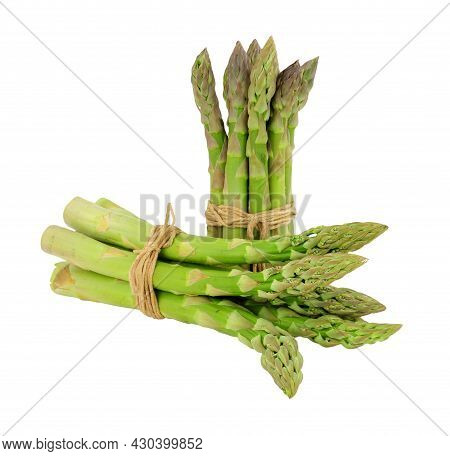 Bundles Of Fresh Raw Asparagus Tips Isolated On A White Background