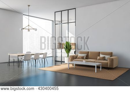 White Living Room Interior With Sofa, Coffee Table And Indoor Plant. Panoramic Dining Area With A Fr