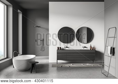 Grey Bathroom Interior With On Trend Tub, Stool, Two Round Mirrors With Vanity, Shower Area, Panoram