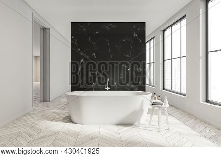Panoramic Bathroom Interior With Light Wood Tile Flooring, Black Partition, White Ceramic Bathtub, S