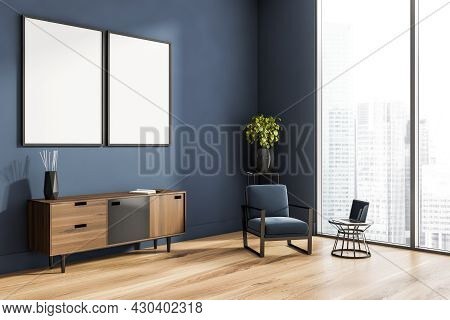 Living Room Interior With Panoramic Window, Two White Poster, Blue Armchair, Closet, Laptop And Oak