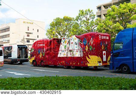 Fuji City, Shizuoka-ken, Japan - June 24, 2021: Tokyo 2020 Olympic Torch Relay. Car Parade With Part