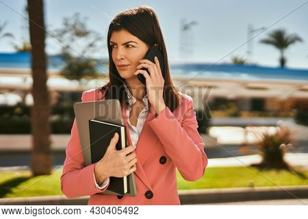 Middle age business woman speaking on the telephone on a work phone call