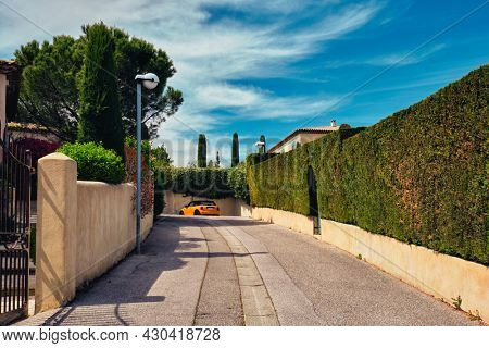 French town street view in town Aix-en-Provence with yellow car. Aix-en-Provence, France