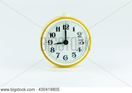 Alarm Clock Yellow Shows The Time 21 O'clock On A White Isolated Background
