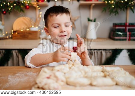 A Little Boy Himself Cooks Dumplings With Cherries In The New Years Kitchen.