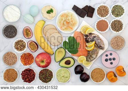 Bipolar disorder and manic depression mood stabilising health food high in omega 3, protein, selenium, magnesium, vitamins, serotonin, tryptophan. Variety of foods, natural herbal medicine concept.