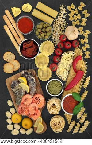 Italian low cholesterol food ingredients for healthy diet with prawns,  oysters,  pasta, fruit, vegetables, sauces, bread products. High in fibre, protein, anthocyanins, omega 3, antioxidants.