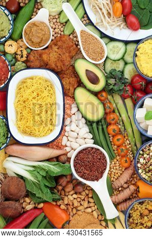 Vegan super food for a healthy life high in antioxidants, protein, omega 3, dietary fibre, anthocyanins, smart carbs, vitamins, minerals and  lycopene. Health care immune system boosting diet concept.
