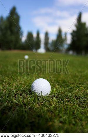 Golf Ball On A Green Grass Background