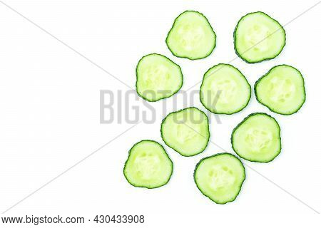 Fresh Sliced Cucumber Cross-sections Isolated On White Background.