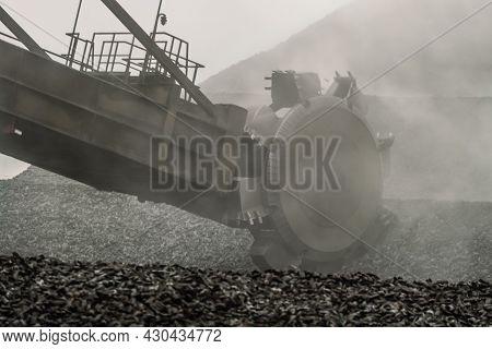 Big Overburden Machine Buckets In Hot Haze. Bucket Wheel Excavator Digs And Loads The Hot Briquetted
