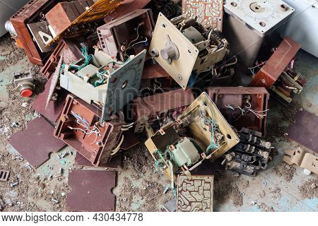 Old Soviet Industrial Electrical Equipment And Electronic Circuits. Bunch Of Old Abandoned Electroni