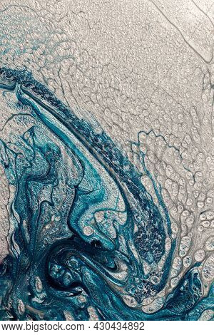 Beautiful Shimmer Blue And Silver Stains Of Liquid Nail Polish With Bubbly Texture,looks Like Ocean