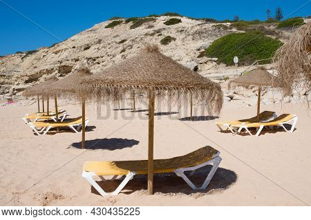 Sunshades And Deck Chairs On The Beach Early In The Morning, Waiting For The Tourists To Arrive. No