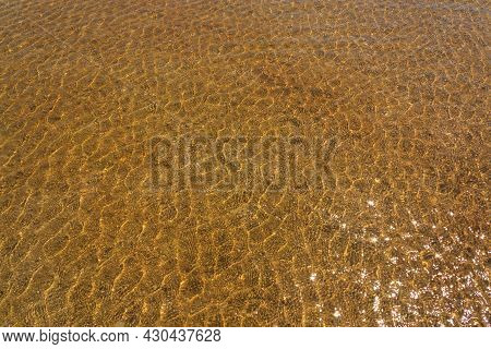 Textured Water Surface. Sea Pattern. Ripples On The Water. Natural Ecological Background.