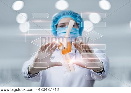 The Concept Of Joint Treatment By Algorithm. Doctor Clicks On A Joint On A Blurred Background.