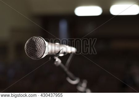 Microphone On An Empty Stage Before The Concert, Stage Lights Are On Behind The Microphone
