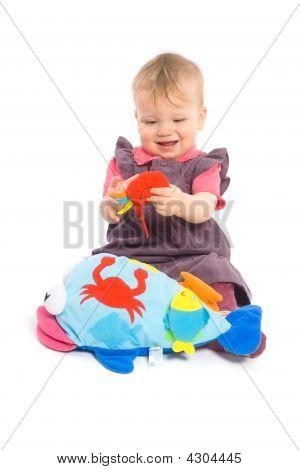 Mädchen spielen mit Spielzeug - isoliert