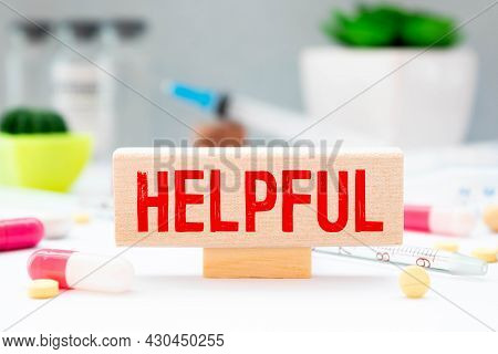 Helpful Tips Symbol. Wooden Blocks With Words Helpful Tips. Beautiful Grey Background.