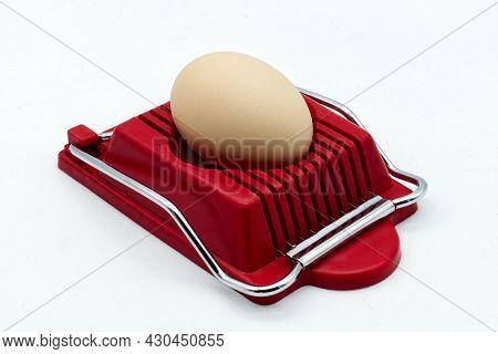 Household Device For Slicing Eggs. Hard-boiled Eggs Slicer Tool.