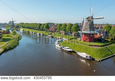 Aerial from traditional windmills in Dokkum Friesland in the Netherlands