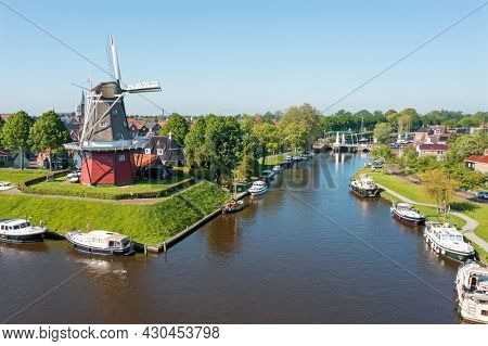 Aerial view on Dokkum with windmill in the Netherlands