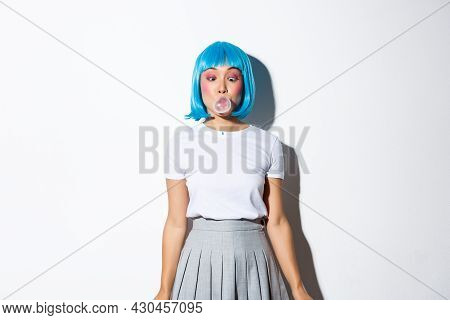 Silly Asian Girl In Blue Wig And School Uniform, Blowing Bubble Gum With Coquettish Expression, Dres