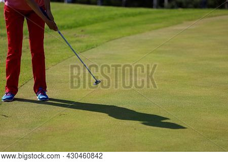 Minsk. Belarus - 24.07.2021 - Low Section Of Man Playing Golf At Driving Range On A Green Field