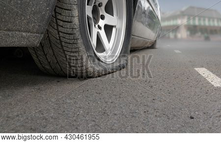 Flat Tire Car On Side Of Street Because Expired Tyre