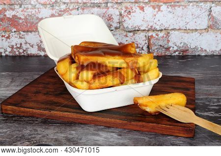Chips And Gravy Meal In A Take Away Box With Lid