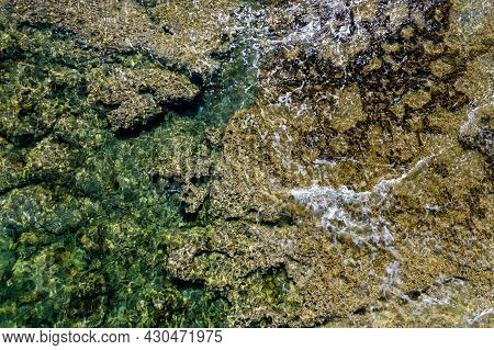 Aerial Drone View Of Sea Transparent Water And Waves With Rocks On The Bottom. Ocean Background