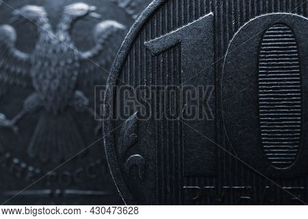 Russian Coins Of 10 Rubles On Both Sides Close Up. Dark Dramatic Background Or Wallpaper In Generic