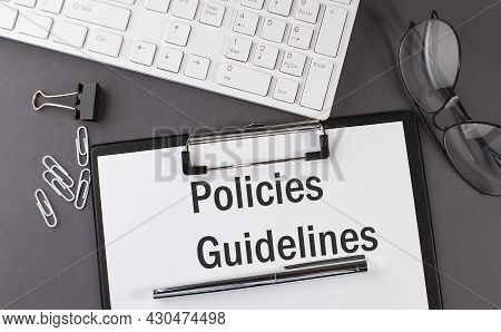 Office Paper Sheet With Text Policies Guidelines And Keyboard. Business