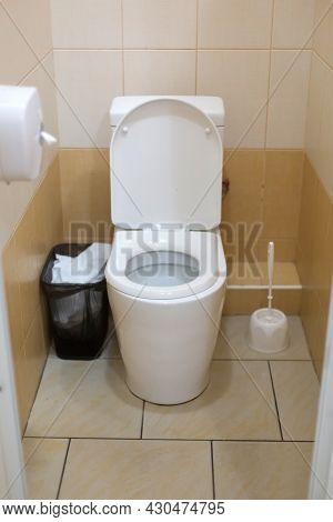 Close Up Of A Clean White Toilet Bowl In A Toilet Room. Hygiene Standards Of A Public Institution